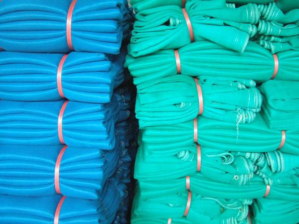 High density debris netting in blue or green color packaged in our warehouse.