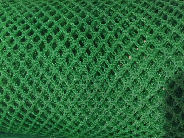 A roll of green debris netting